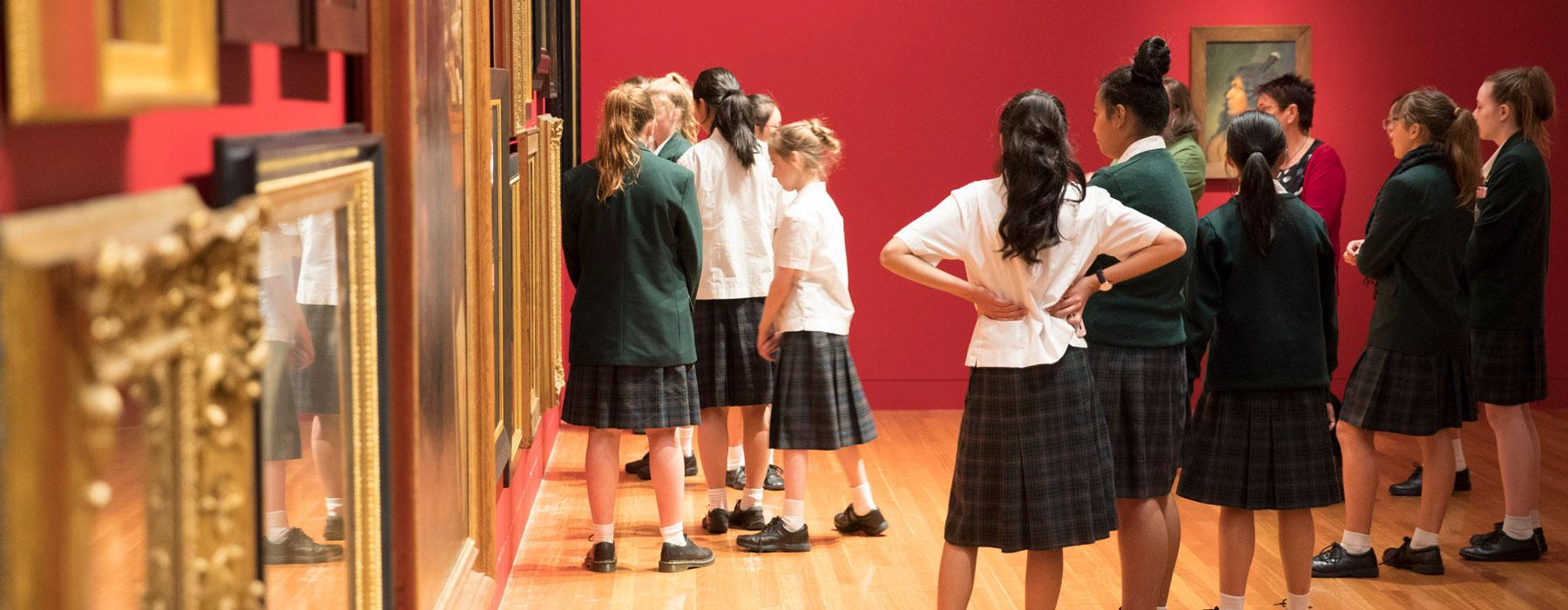 School girls look at historical art