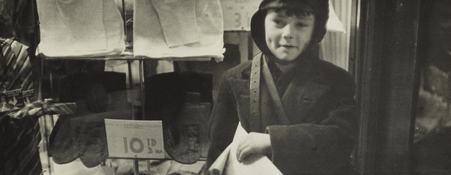 Wellington's smallest newsboy, Cuba St, 1938, Wellington, by Eric Lee-Johnson. Purchased 1997 with New Zealand Lottery Grants Board funds. Te Papa (O.006586)