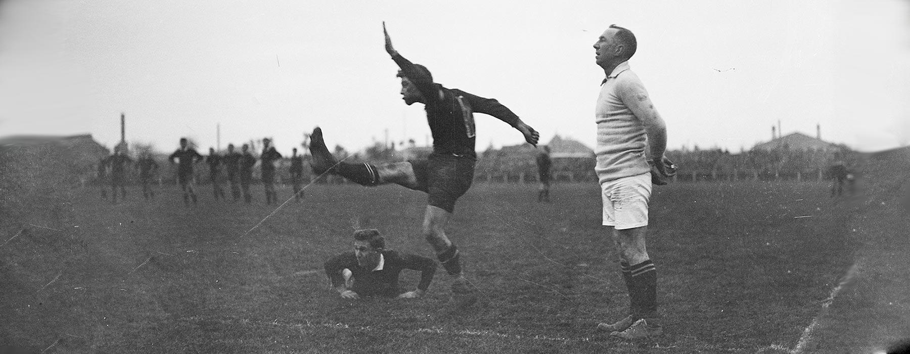 Man kicking ball