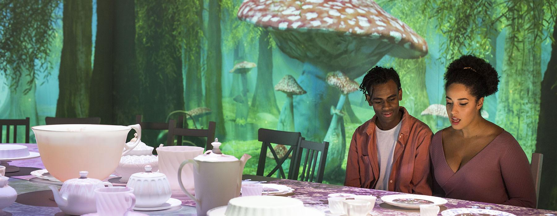 Two people take part in a Mad Hatter's Tea Party