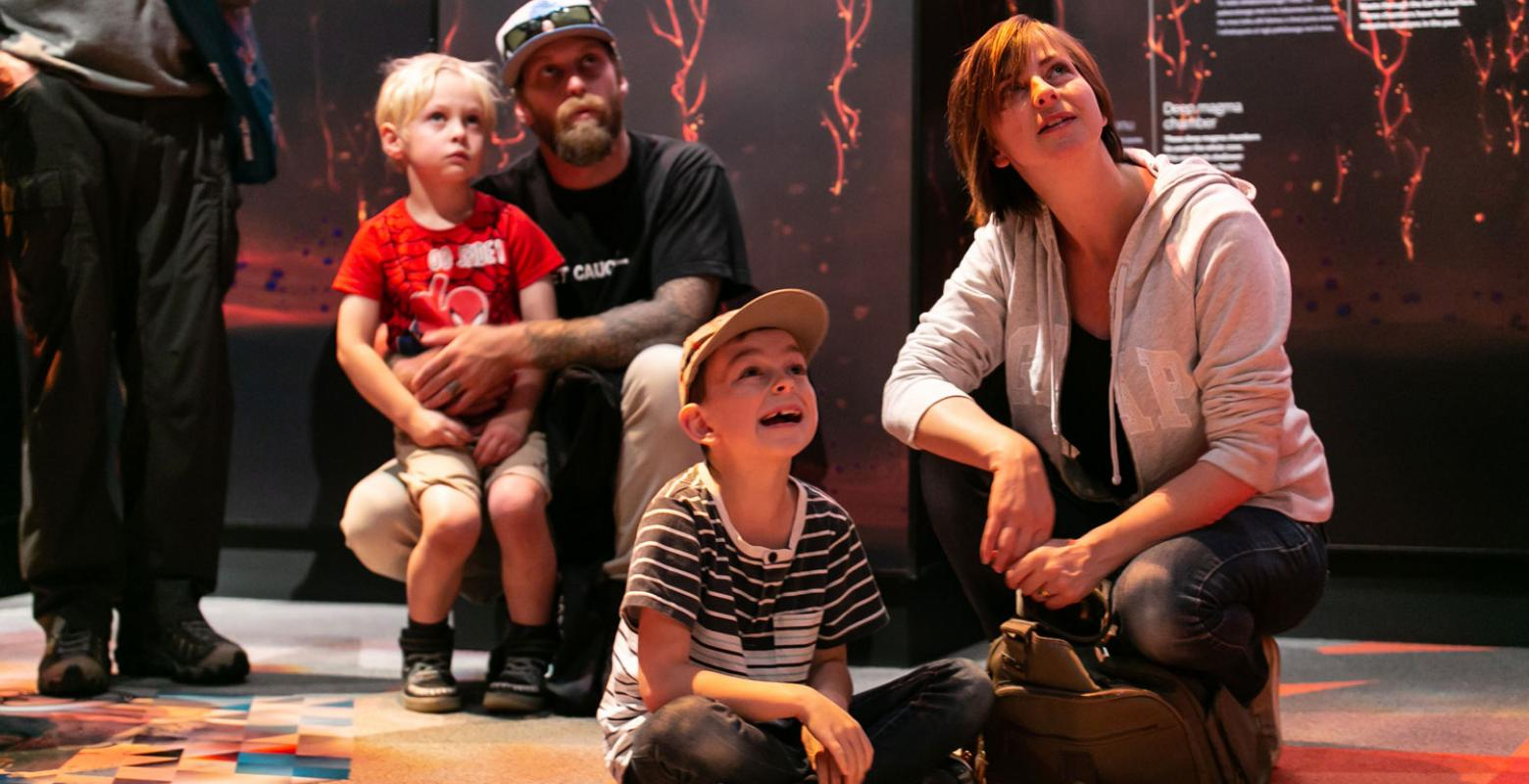 A family watching the Taupō Super-volcano animation