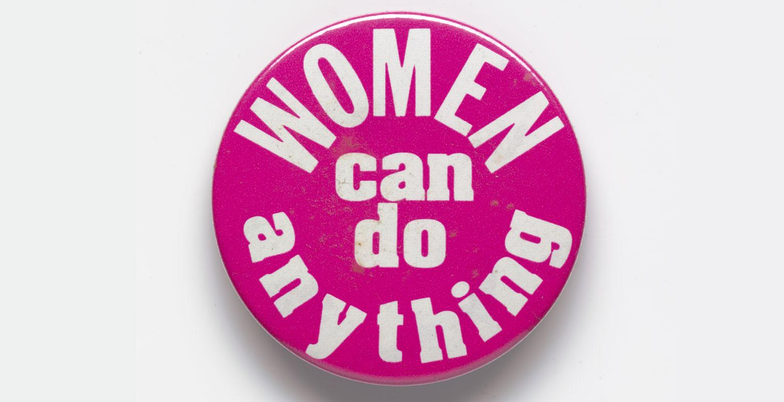 Pink badge with the words 'Women can do anything'