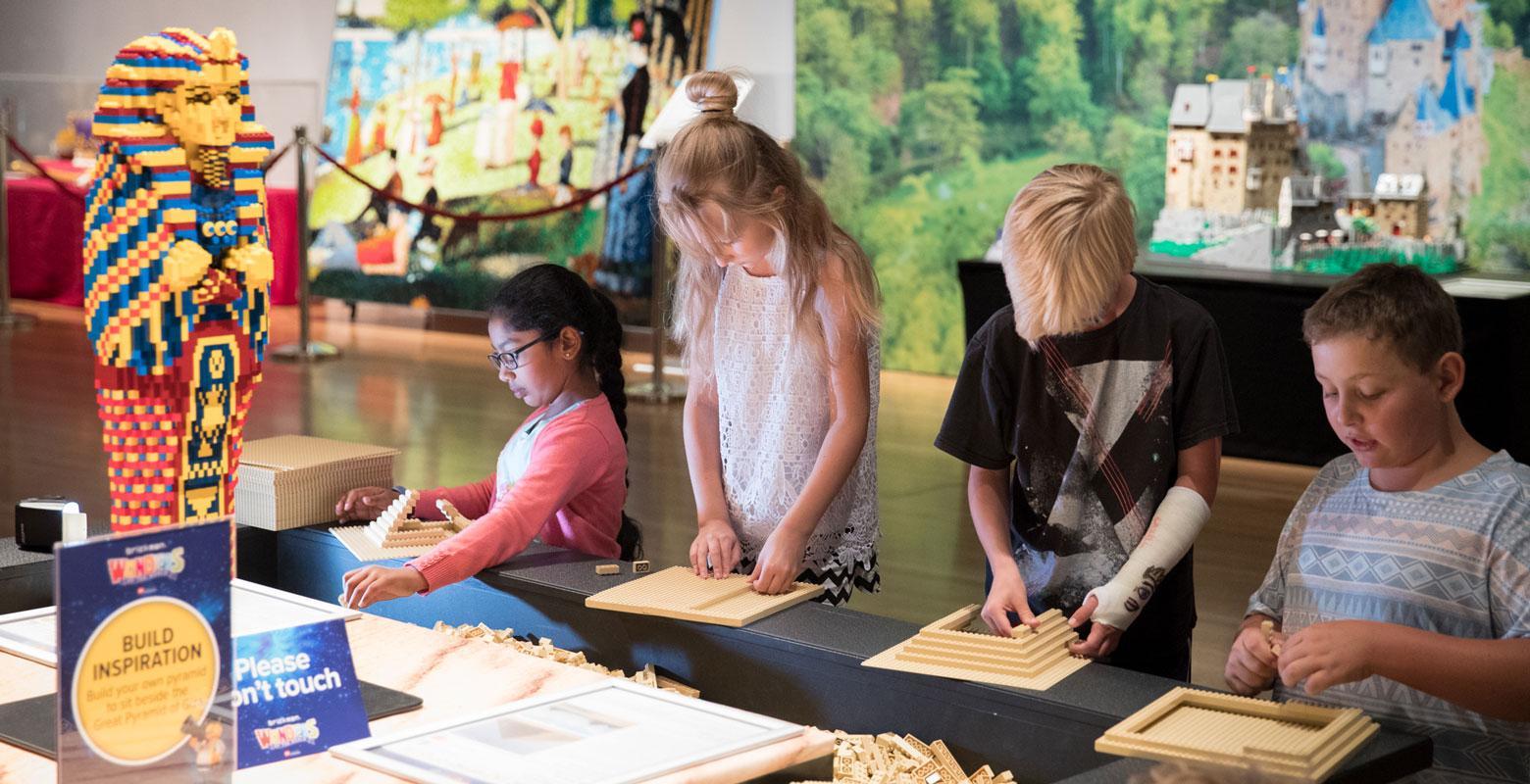 Children building LEGO pyramids