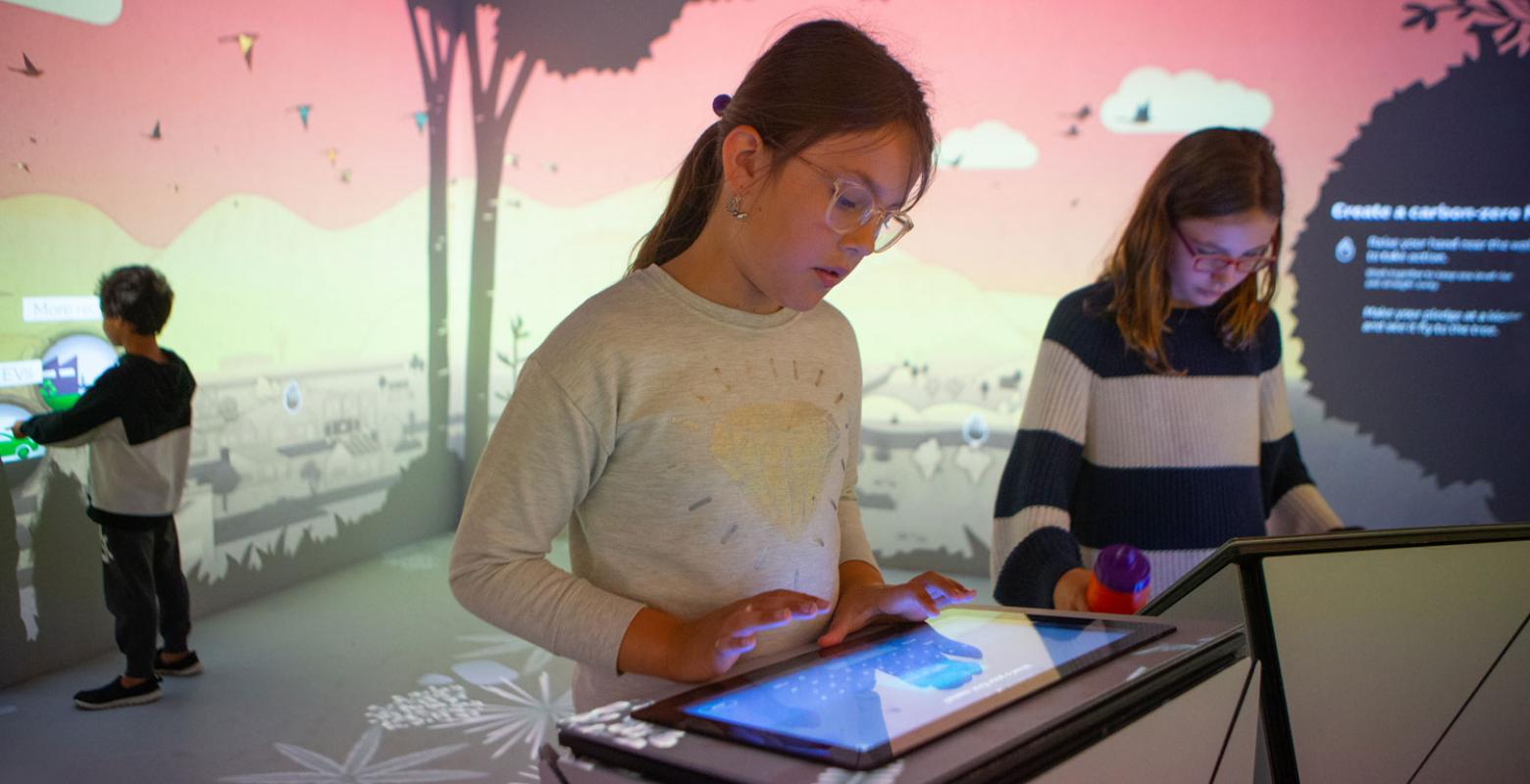 Children play with a digital interactive