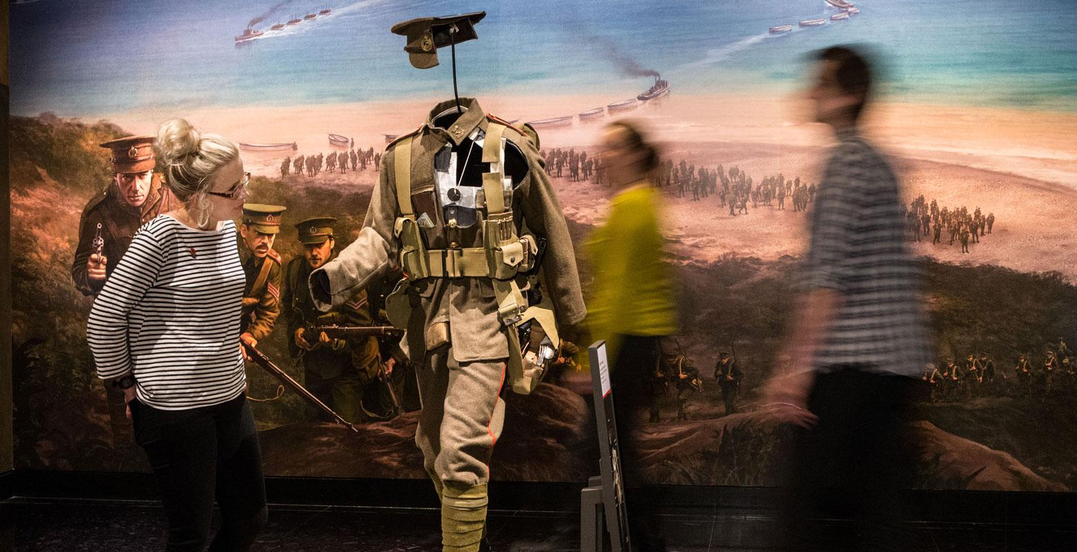 Visitors examine the cut-through model of soldiers' kit