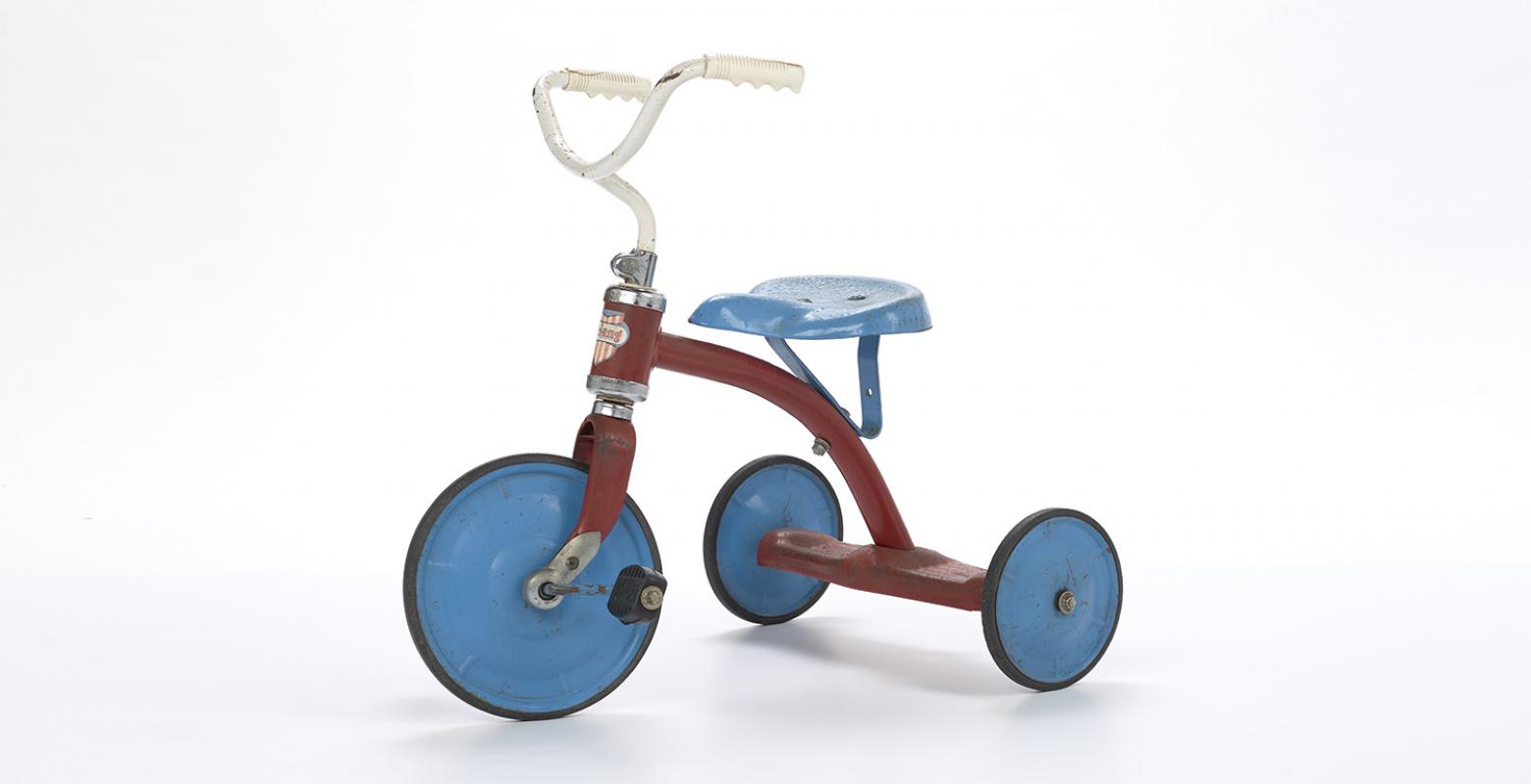 A blue, red and white tricycle