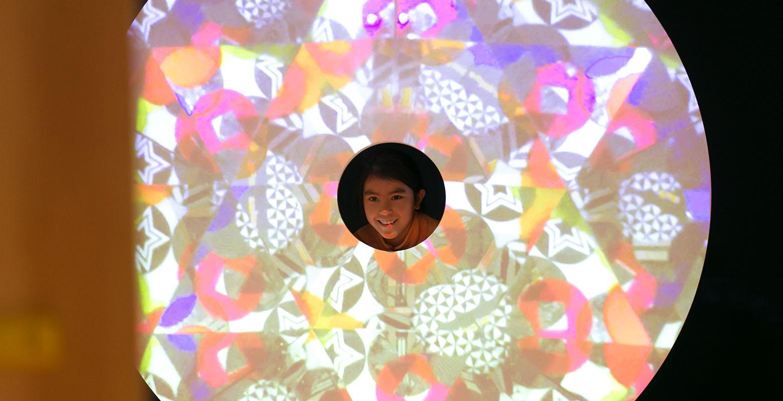 Child plays with the giant kaleidoscope
