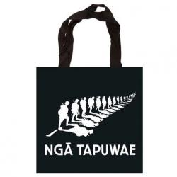 Black tote bag with Ngā Tapuwae logo on it – a silver fern made up of the silhouettes of soldiers instead of fronds