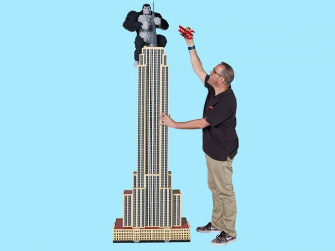 Man with giant LEGO model of the Empire State Building