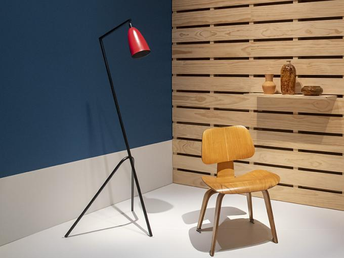a lamp, and a chair on a blue and wooden platform