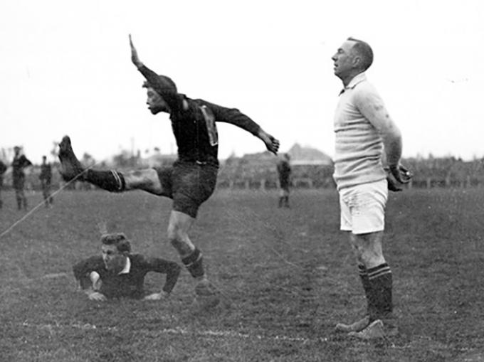 Rugby player kicking for goal, circa 1922
