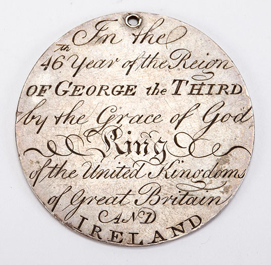 Medal with text engraved that reads In the 46th year of the Reign of George the Third by the Grace of God King of the United Kingdoms of Great Britain and Ireland