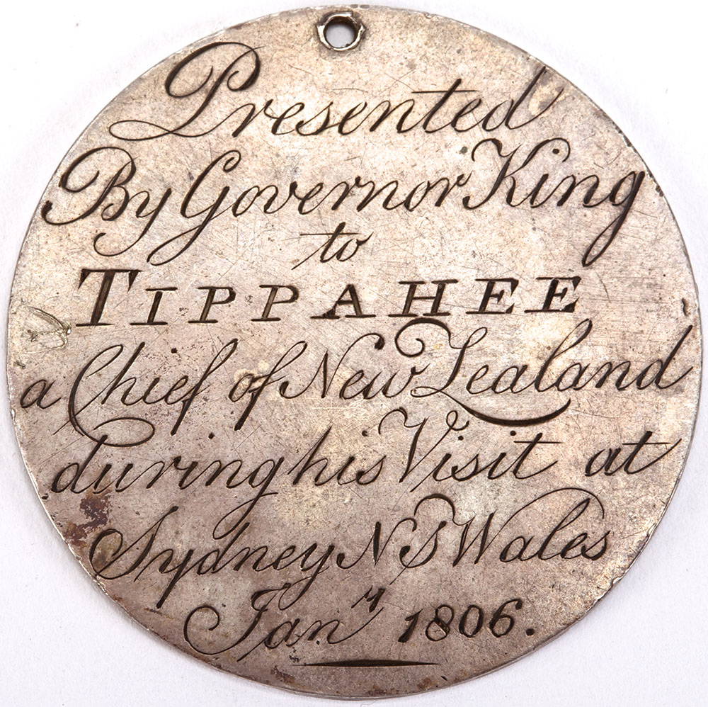 Medal with text engraved that reads Presented by Governor King to Tippahee a Chief of New Zealand during his visit at Sydney NS Wales January 1806