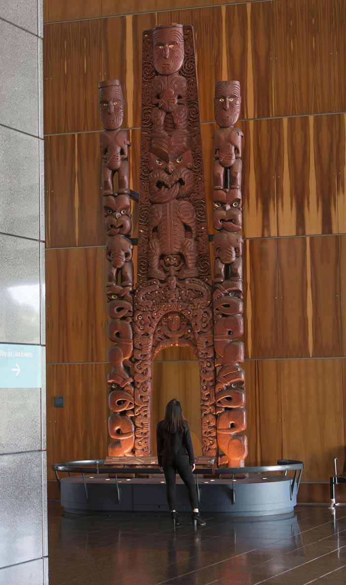 Woman looking at Waharoa, 2015. Photograph by Michael Hall. Te Papa