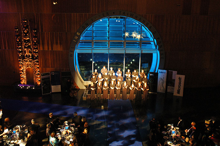 Choir singing at the large window in the Wellington Foyer